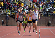 Apr 28, 2018; Philadelphia, PA, USA; Casey Comber of Villanova (G) defeats Amos Bartelsmeyer of Georgetown (F) on the anchor of the Championship of America 4 x mile relay, 16:23.75 to 16:24.22, during the 124th Penn Relays at Franklin Field.