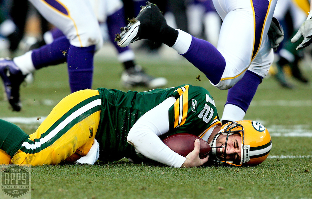Green Bay Packers' Aaron Rodgers is sacked by Minnesota Vikings' Jared Allen for a 8-yard loss in the 2nd quarter. .The Green Bay Packers hosted the Minnesota Vikings at Lambeau Field Sunday November 1, 2009. Steve Apps-State Journal.