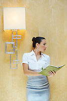 Business woman reading document in office