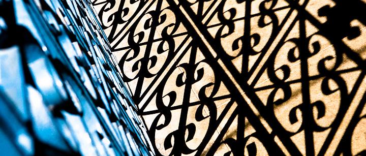 A gate at the Tibetan Refugee Camp in Kathmandu creates a mosaic of shadows.