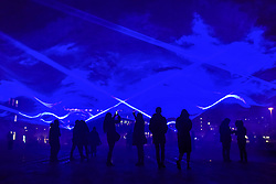 "© Licensed to London News Pictures. 17/01/2018. LONDON, UK. People view ""Waterlicht"" by Daan Roosegaarde in Granary Square, Kings Cross.  Preview of Lumiere London, the capital's largest arts festival commissioned by The Mayor of London and produced by Artichoke.  Light installations by leading artists have been set up, both north and south of the river for the public to view 18-21 January.   Photo credit: Stephen Chung/LNP"