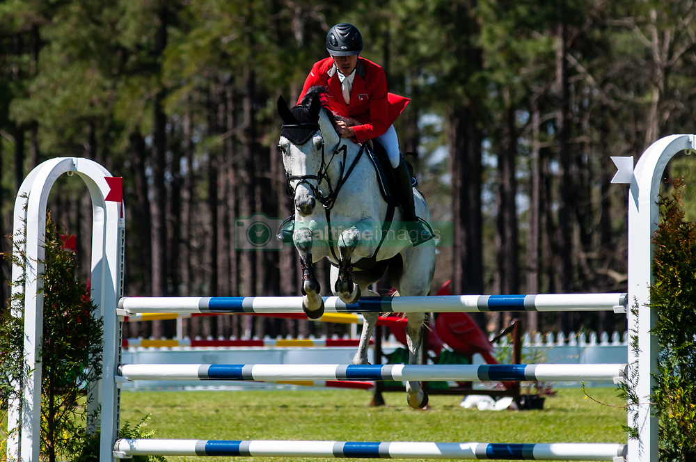 March 22, 2019 - Raeford, North Carolina, US - March 22, 2019 - Raeford, N.C., USA - FELIX VOGG of Switzerland riding CAYENNE competes in the show jumping CCI-4S division at the sixth annual Cloud 11-Gavilan North LLC Carolina International CCI and Horse Trial, at Carolina Horse Park. The Carolina International CCI and Horse Trial is one of North AmericaÃ•s premier eventing competitions for national and international eventing combinations, hosting International competition at the CCI2*-S through CCI4*-S levels and National levels of Training through Advanced. (Credit Image: © Timothy L. Hale/ZUMA Wire)