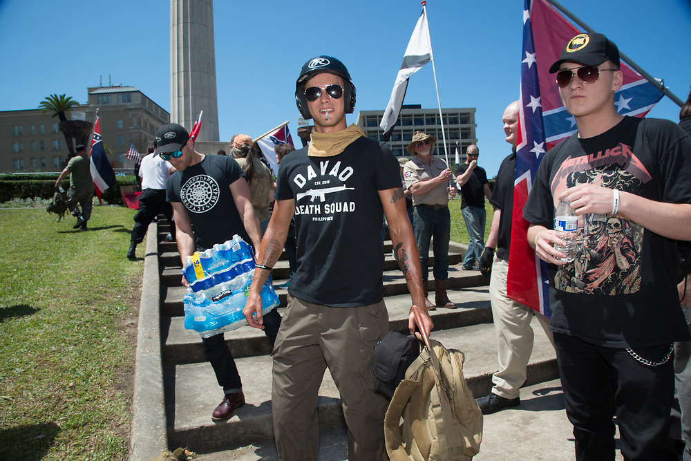 "Protesters who came to Lee Circle to stand up to the ""Antifa"" who were coming to the the circle to celebrate the fact the city will taken down three more Confederate Monuments."
