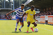 AFC Wimbledon striker Dominic Poleone (10) and Reading FC defender Tennai Watson battle during the Pre-Season Friendly match between AFC Wimbledon and Reading at the Cherry Red Records Stadium, Kingston, England on 23 July 2016. Photo by Stuart Butcher.