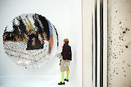UK. London. The Frieze Art Fair in Reagent's Park.<br /> Photo shows people looking at an Anish Kapoor piece 'Untitled 2008'.