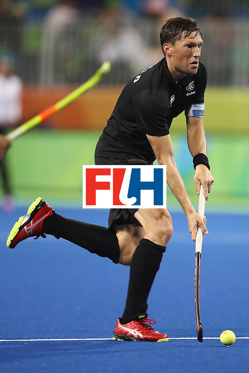 RIO DE JANEIRO, BRAZIL - AUGUST 10:  Simon Child of New Zealand runs the ball forward during the men's pool A match between New Zealand and Brazil on Day 5 of the Rio 2016 Olympic Games at the Olympic Hockey Centre on August 10, 2016 in Rio de Janeiro, Brazil.  (Photo by Mark Kolbe/Getty Images)