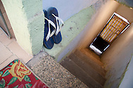 Binho's Flip Flops, entrance to Binho s house 2006. Herbeson Binho Alves Parada de Lucas/Linda Primavera Binho now 27 lived in Parada de Lucas in 2006 he moved to Linda Primavera two years ago partly due to the murder of his father. As with many tragedies in the favela there is still no clear reason for his father's death especially confusing because he had nothing to do with the local drug faction. Binho has been enterprising enough to land himself a job as a digital communications specialist. With a payout from his previous job Binho was able to buy some land in Linda Primavera a suburb just north of Rio de Janeiro his house is the second to be constructed on a street that still has no name. He is currently extending his own house building a house for his brother in law and has plans to also build homes for his mother and mother in law on the same property. Life is much calmer and safer now. <br />