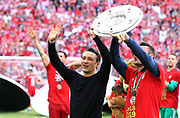 FcBayern coach Niko KOVAC and assistant coach Robert KOVAC with the trophy, <br /> Bayern Munich's Croatian headcoach Niko Kovac celebrates with the trophy after his team's championship victory after the German First division Bundesliga football match, <br /> MUNICH, 18. MAY 2019,  Fc BAYERN vs Eintracht FRANKFURT, 5:1 - Bundesliga Football Match, <br /> FcBayern Muenchen vs Eintracht FRANKFURT Bundesliga match at Allianz Arena on 18.05.2019, DFL REGULATIONS PROHIBIT ANY USE OF PHOTOGRAPHS AS IMAGE SEQUENCES AND/OR QUASI-VIDEO - fee liable image, <br /> copyright &copy; ATP / Arthur THILL