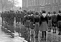 Para-military style marchers at the Belfast funeral, 23rd November 1974, of James McDade, 26 years, married, 1 child, Roman Catholic, lieutenant, Provisional IRA,  Birmingham, England, who died when bomb he was planting at a telephone exchange / sorting office in Coventry exploded prematurely. He was a native of the Ardoyne district of Belfast, N Ireland. 197411230651a.<br /> <br /> Copyright Image from Victor Patterson, 54 Dorchester Park, Belfast, UK, BT9 6RJ<br /> <br /> t: +44 28 90661296<br /> m: +44 7802 353836<br /> vm: +44 20 88167153<br /> e1: victorpatterson@me.com<br /> e2: victorpatterson@gmail.com<br /> <br /> For my Terms and Conditions of Use go to www.victorpatterson.com