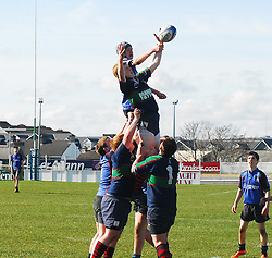 Rice College's Eddie Dunning competes for at the lineout against Calasantius Liam Keaveney ...Pic Conor McKeown
