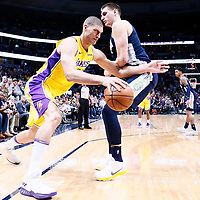 09 March 2018: Los Angeles Lakers center Brook Lopez (11) drives past Denver Nuggets center Nikola Jokic (15) during the Denver Nuggets125-116 victory over the Los Angeles Lakers, at the Pepsi Center, Denver, Colorado, USA.