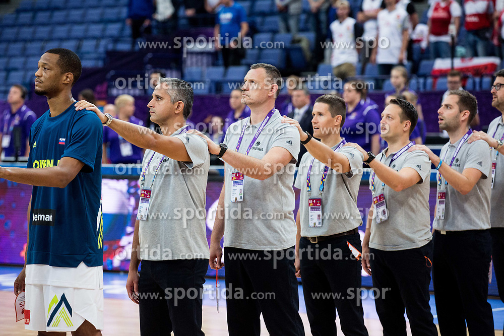 Anthony Randolph of Slovenia, Igor Kokoskov, coach of Slovenia, Rado Trifunovic, assistant coach of Slovenia, Jaka Lakovic, assistant coach of Slovenia, Aleksander Sekulic, assistant coach of Slovenia listening to the national anthem during basketball match between National Teams of Slovenia and Poland at Day 1 of the FIBA EuroBasket 2017 at Hartwall Arena in Helsinki, Finland on August 31, 2017. Photo by Vid Ponikvar / Sportida
