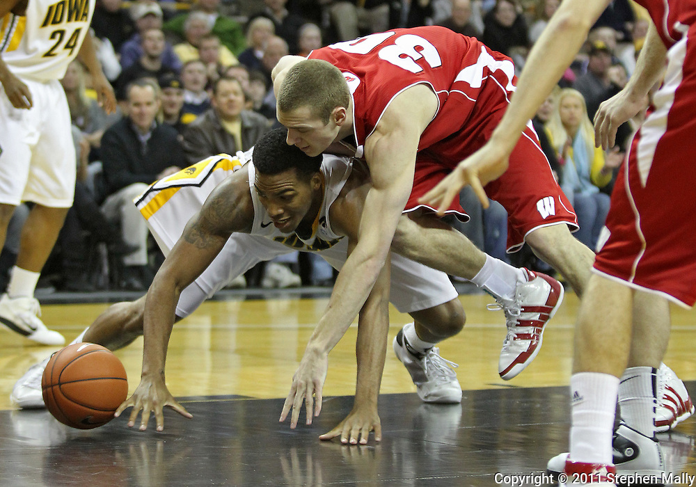 February 09 2011: Iowa Hawkeyes forward Jarryd Cole (50) and Wisconsin Badgers forward Jon Leuer (30) battle for a lose ball during the first half of an NCAA college basketball game at Carver-Hawkeye Arena in Iowa City, Iowa on February 9, 2011. Wisconsin defeated Iowa 62-59.