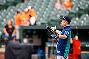 "Baltimore, Maryland - June 25, 2018: Seattle Mariners star Ichiro Suzuki makes a fun gesture after his last flight of batting practice before the Mariners played the Orioles at Camden Yards in Baltimore Monday June 25, 2018.<br /> (editor's note: I believe this gesture might've been a little self deprecating but also, maybe, celebratory. I think he hit several balls out of the park during batting practice -- I'm not positive because I was focusing on Ichiro's reactions.)<br /> <br /> <br /> Seattle Mariners star Ichiro Suzuki goes through all the pre-game warm ups like any position player on the Seattle Mariners, before their game against the Baltimore Orioles at Camden Yard Monday June 25th  -- except his current position is ""Special Assistant to the Chairman,"" in the ball club's front office.<br /> He does everything an active player does except play. His new position in management forbids him from being in the dugout during game play, so he soaks up as much time with the players before the first pitch. <br /> <br /> CREDIT: Matt Roth for The New York Times<br /> Assignment ID: 30221475A"
