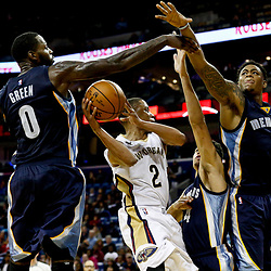 Dec 5, 2016; New Orleans, LA, USA; New Orleans Pelicans guard Tim Frazier (2) shoots as Memphis Grizzlies forward JaMychal Green (0) and guard Wade Baldwin IV (4) and forward Jarell Martin (1) during the second half of a game at the Smoothie King Center. The Grizzlies defeated the Pelicans 110-108 in double overtime.  Mandatory Credit: Derick E. Hingle-USA TODAY Sports