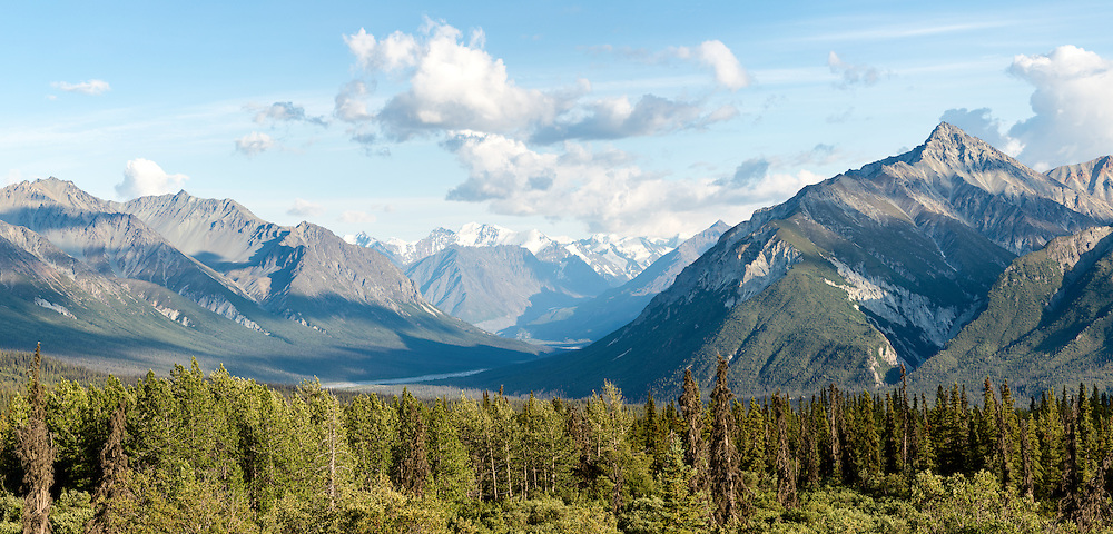 Composite panorama of Majestic Valley as it joins Matanuska Valley in Southcentral Alaska. Summer. Evening.