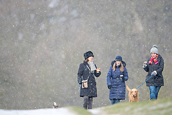 © Licensed to London News Pictures. 26/02/2018. London, UK. Dog walkers brave heavy snowfall and freezing temperatures in Richmond Park, west London, as a cold front sweeps in from the east. Up to 20cm of snow are expected in parts of the UK, with temperatures feeling as low as -15C in some places. Photo credit: Ben Cawthra/LNP