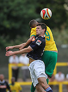 Picture by David Horn/Focus Images Ltd +44 7545 970036<br /> 16/07/2013<br /> Ryan Charles of Hitchin Town and Andy Parry of Luton Town in an aerial battle during the Pre Season Friendly match at Top Field, Hitchin.