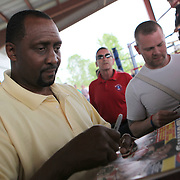 """Inductee Thomas """"Hitman"""" Hearns signs autographs during the 23rd Annual International Boxing Hall of Fame Induction ceremony at the International Boxing Hall of Fame on Sunday, June 10, 2012 in Canastota, NY. (AP Photo/Alex Menendez)"""