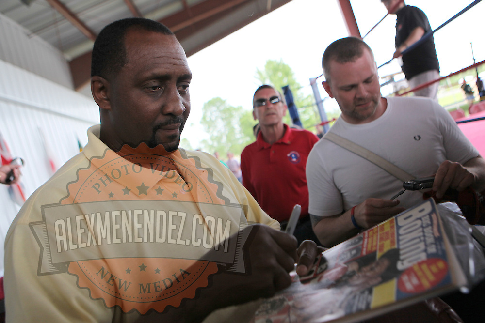 "Inductee Thomas ""Hitman"" Hearns signs autographs during the 23rd Annual International Boxing Hall of Fame Induction ceremony at the International Boxing Hall of Fame on Sunday, June 10, 2012 in Canastota, NY. (AP Photo/Alex Menendez)"
