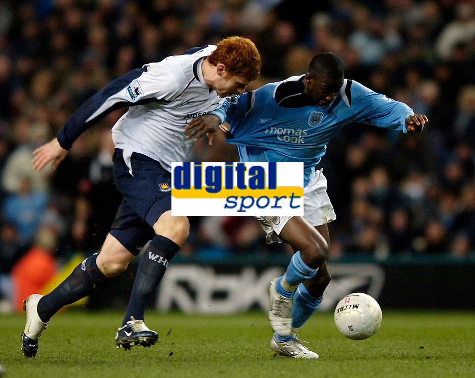 Photo: Jed Wee.<br /> Manchester City v West Ham United. The FA Cup. 20/03/2006.<br /> <br /> West Ham's James Collins (L) tries to pull Manchester City's Bradley Wright-Phillips back.