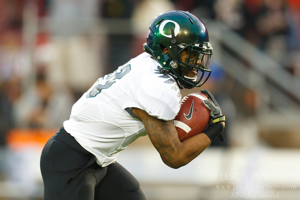 Nov 12, 2011; Stanford CA, USA;  Oregon Ducks running back LaMichael James (21) warms up before the game against the Stanford Cardinal at Stanford Stadium.  Oregon defeated Stanford 53-30. Mandatory Credit: Jason O. Watson-US PRESSWIRE
