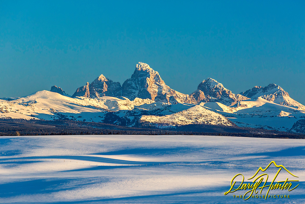 Snowfields and the Grand Tetons in Teton Valley near Ashton Idaho.
