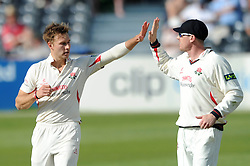 Kyle Jarvis for Lancashire Cricket celebrates with James Faulkner  - Photo mandatory by-line: Dougie Allward/JMP - Mobile: 07966 386802 - 07/06/2015 - SPORT - Football - Bristol - County Ground - Gloucestershire Cricket v Lancashire Cricket - LV= County Championship