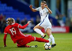 Ekaterina Morozova of Russia tackles Fran Kirby of England - Mandatory by-line: Matt McNulty/JMP - 19/09/2017 - FOOTBALL - Prenton Park - Birkenhead, United Kingdom - England v Russia - FIFA Women's World Cup Qualifier