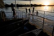 A family swims from the shipping dock at Puerto Narino - Amazonas - Colombia