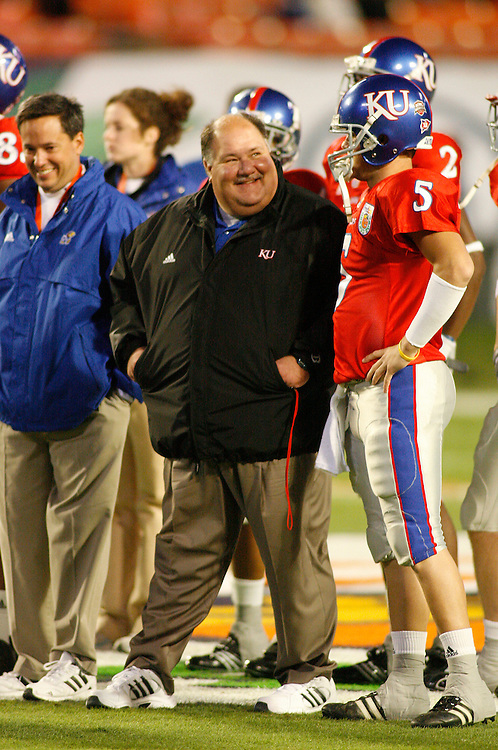 January 3, 2008 - Miami Gardens, FL<br /> <br /> Kansas head coach Mark Mangino watches his players warm up before Kansas' 24-21 victory over Virginia Tech in the 2008 Orange Bowl Classic at Dolphin Stadium in Miami Gardens, Florida.<br /> <br /> JC Ridley/CSM