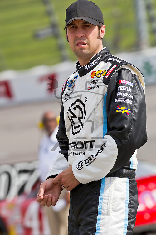 NEWTON, IA - MAY 19, 2012:  Sam Hornish, Jr. (12) prepares to qualify for the Pioneer Hi-Bred 250 at the Iowa Speedway in Newton, IA.