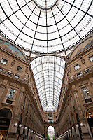 Milan, Italy. Galleria - looking up toward the glass dome with elegant facades to either side.