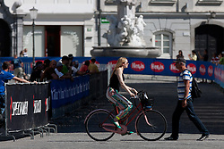 Pedestrian and girl with bicycle at prologue (17,8km) of Tour de Slovenie 2012, on June 17 2012, in Ljubljana, Slovenia. (Photo by Matic Klansek Velej / Sportida.com)