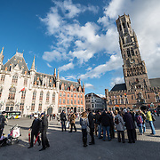 People gather in the Markt (Market Square) in the historic center of Bruges, a UNESCO World Heritage site.