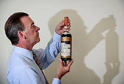 Pictured: Bonham's Whisky expert Martin Green with a rare bottle of 60 year old Macallan  Valerio Adami whisky, which is expected to sell for close to 1 million GBP at auction in Edinburgh in October, making it the most expensive bottle of whisky ever sold.<br /> <br /> &copy; Dave Johnston / EEm