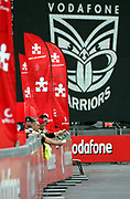 Spectators watch from behind the Vodafone signs at the Warriors and Eels at Mt Smart Stadium, Auckland, New Zealand on Saturday 17 March 2007. The Warriors won the match 34 - 18. Photo: Hannah Johnston/PHOTOSPORT<br /> <br /> <br /> <br /> 170307