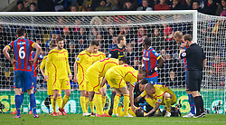 LONDON, ENGLAND - Saturday, February 14, 2015: Concerned Liverpool players look as as Mamadou Sakho lies injured during the FA Cup 5th Round match against Crystal Palace at Selhurst Park. (Pic by David Rawcliffe/Propaganda)