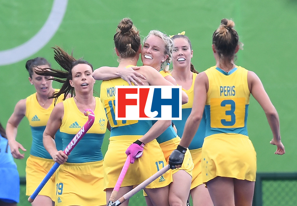 Australia's Georgina Morgan (3L) celebrates scoring a goal with teammates during the women's field hockey India vs Australia match of the Rio 2016 Olympics Games at the Olympic Hockey Centre in Rio de Janeiro on August, 10 2016. / AFP / MANAN VATSYAYANA        (Photo credit should read MANAN VATSYAYANA/AFP/Getty Images)