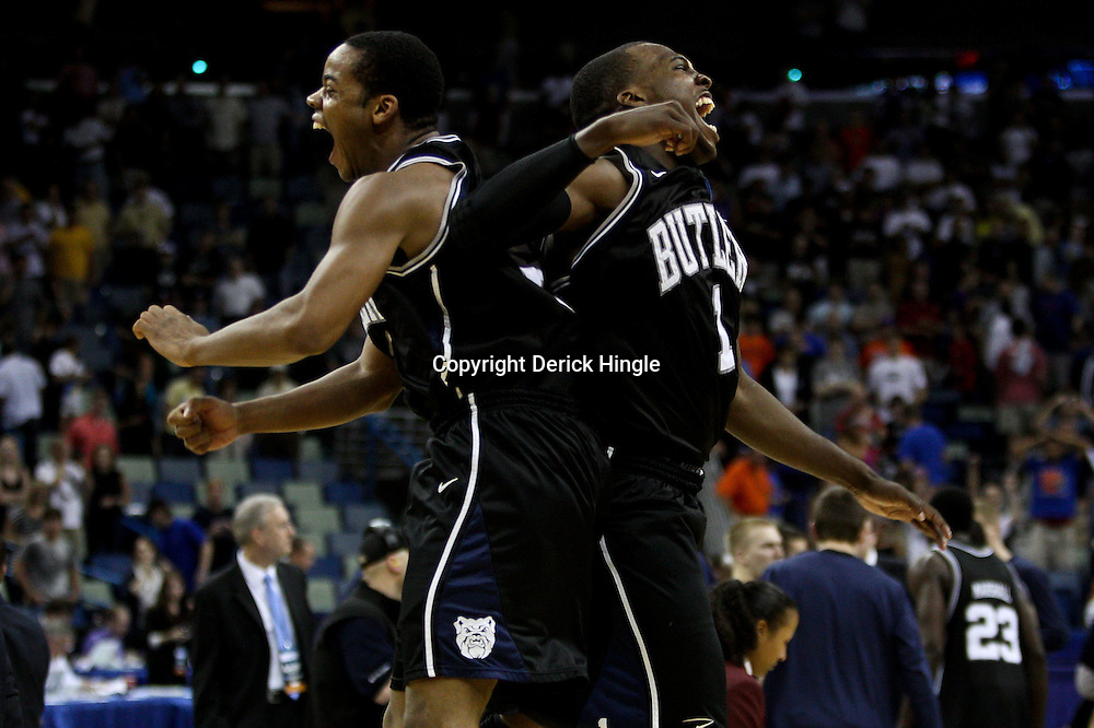 Mar 26, 2011; New Orleans, LA; Butler Bulldogs guard Ronald Nored (left) and guard Shelvin Mack (1) celebrate following a win over the Florida Gators in the semifinals of the southeast regional of the 2011 NCAA men's basketball tournament at New Orleans Arena. Butler defeated Florida 74-71.  Mandatory Credit: Derick E. Hingle