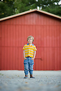 Small boy child in farm fashion