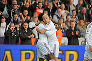 Wilfried Bony is congratulated on his first half goal by team mate Jonjo Shelvey.<br /> Barclays Premier league match, Swansea city v Crystal Palace at the Liberty stadium in Swansea, South Wales on Saturday 29th November 2014<br /> pic by Phil Rees, Andrew Orchard sports photography.