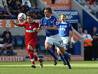 Photo: Kevin Poolman.<br />Leicester City v Colchester United. Coca Cola Championship. 23/09/2006. Jamie Cureton (Colchester) and Leicester's Gareth McCarthy fight over the ball.