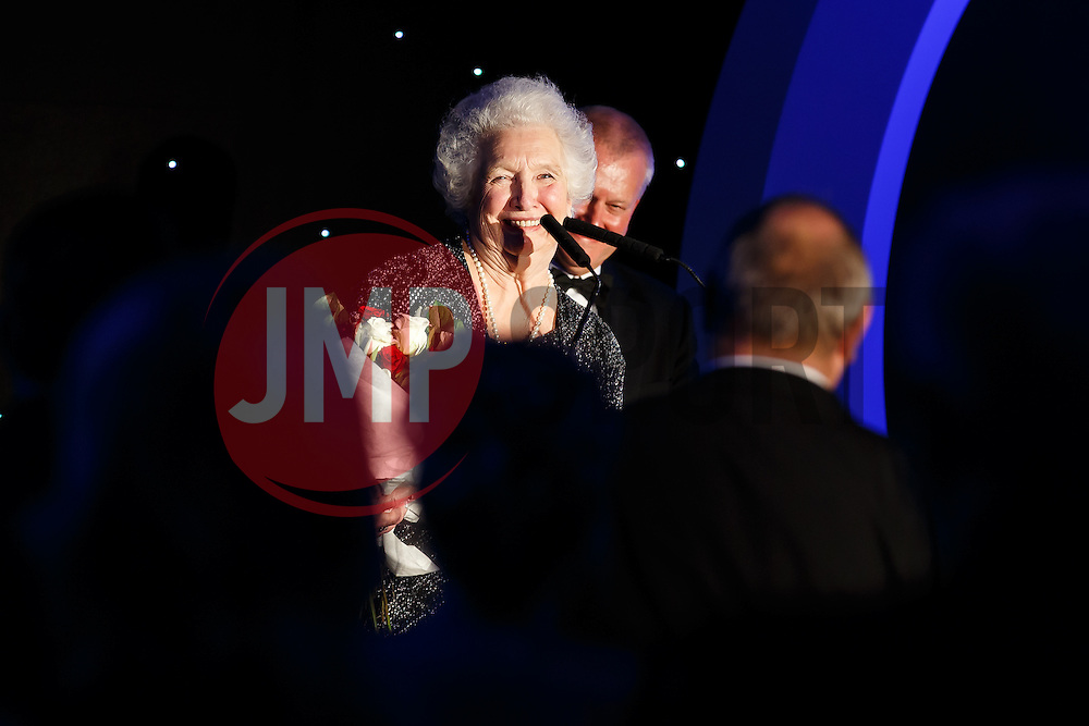 Marina Dolman takes to the stage at Bristol Sport's Annual Gala Dinner with Steve Lansdown who announces a road in part of the redevloped Ashton Gate Stadium will be named Marina Dolman Way in her honour - Mandatory byline: Rogan Thomson/JMP - 08/12/2015 - SPORT - Ashton Gate Stadium - Bristol, England.