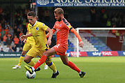 Luton Town midfielder Andrew Shinnie (11) makes a tackle on Bristol Rovers attacker Tom Nichols (10) during the EFL Sky Bet League 1 match between Luton Town and Bristol Rovers at Kenilworth Road, Luton, England on 15 September 2018.