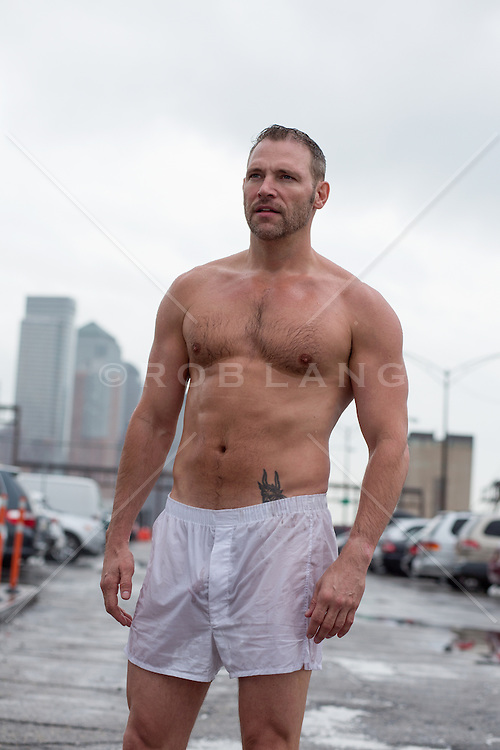 man in white boxers on a rooftop in New York City