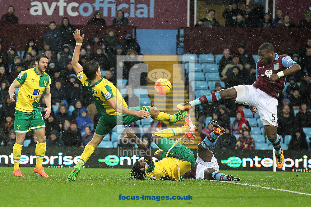 Timm Klose of Norwich and Jores Okore of Aston Villa in action during the Barclays Premier League match at Villa Park, Birmingham<br /> Picture by Paul Chesterton/Focus Images Ltd +44 7904 640267<br /> 06/02/2016