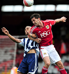 Bristol City's Jamie McAllister battles for the high ball with West Bromwich Albion's Peter Odemwingie   - Photo mandatory by-line: Joseph Meredith / JMPUK - 30/07/2011 - SPORT - FOOTBALL - Championship - Bristol City v West Bromwich Albion - Ashton Gate Stadium, Bristol, England