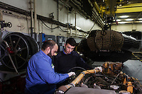 "VALLETTA, MALTA - 8 FEBRUARY 2017: Petty officials of the Libyan Navy Coastguard repair a marine engine during a mechanics course in the hangar of the San Giorgio, an amphibious transport dock of the Italian Navy, in Valetta, Malta, on Febuary 8th 2017.<br /> <br /> As a consequence of the April 2015 Libya migrant shipwrecks, the EU launched a military operation known as European Union Naval Force Mediterranean (EUNAVFOR Med), also known as Operation Sophia, with the aim of neutralising established refugee smuggling routes in the Mediterranean. The aim of this new operation launched by Europe is to undertake systematic efforts to identify, capture and dispose of vessels as well as enabling assets used or suspected of being used by migrant smugglers or traffickers. On 20 June 2016, the Council of the European Union extended Operation Sophia's mandate reinforcing it by supporting the training of the Libyan coastguard.<br /> Thus far, following EUNAVFOR MED operation Sophia's activities, 101 suspected smugglers and traffickers have been apprehended and transferred to the Italian<br /> authorities and 380 boats were removed from the criminal organizations' availability. The Operation has saved 32.081 migrants, among whom 1888 children.<br /> <br /> On February 2nd 2017 Italian Premier Paolo Gentiloni and Prime Minister of the U.N. backed Libyan government Fayez al-Serraj signed a memorandum of understanding on cooperation to combat illegal migration, human trafficking and contraband and on reinforcing the border between Libya and Italy. The following day, as EU leaders meet in Malta for a summit, European Council President Donald Tusk said after talks with Serraj, that ""it is time to close the (migrant) route from Libya to Italy"" and that ""the EU has shown it is able to close the routes of irregular migration, as it has done in the eastern Mediterranean.""  Tusk said the Central Mediterranean route was ""not sustainable either for the EU or for Libya"", where he said traffickers were undermin"