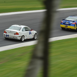 May 23, 2009; Lakeville, CT, USA; The Next Generation/T Giovanis Motorsports BMW 330 (64) chases the 89 Racing Team Honda Civic SI (189) through Diving Turn during the Grand-Am Koni Sports Car Challenge series competition during the Memorial Day Road Racing Classic weekend at Lime Rock Park.
